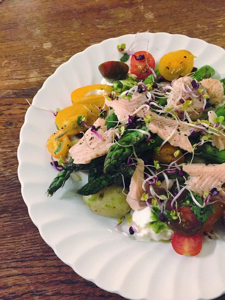 Smoked trout, griddled asparagus and Jersey royal salad with charred lemon and wild garlic